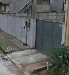 Duas casas em terreno 315 m² 2 min Centro Sta Cruz Serra vendo com RGI terreno