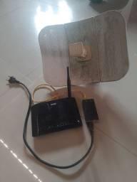 Vendo roteador com a fonte e a antena