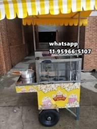 carrinho de pipoca doce e salgada com toldo amarelo