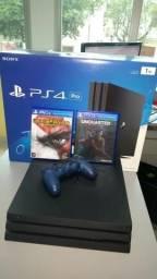 Playstation 4 Pro - Com jogos de brinde - Aceitamos video games como parte do pagamento