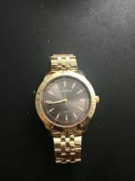 c708e96cbec Relógio Mondaine dourado