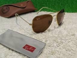 7ca3731de6551 Óculos Ray Ban Aviadro dourado com lentes marrom
