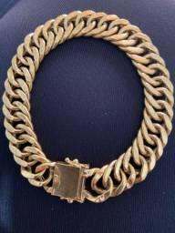Pulseira oca de ouro grumet duplo usada porém conservada