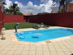 Bela casa com seis suítes a 15 m da praia do Atalaia