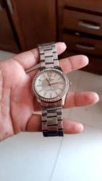 Vendo este relógio Feminino 60,00