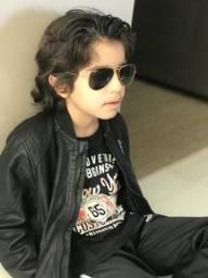Jaqueta preta de couro tamanho 12 anos