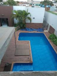 Casa com piscina aquecida, armário embutido e ar condicionados