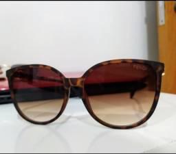 Óculos de sol oncinha