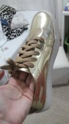 Tênis vizzano Dourado é com zipe
