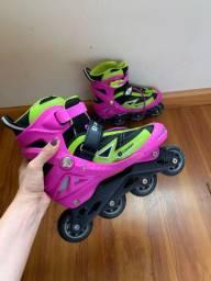 Roller/patins rosa oxer na caixa