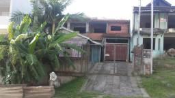 Vendo terreno com casa escriturado no loteamento paiquerê