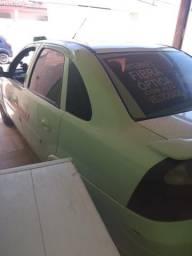 Vendo ou troco Corsa sedan com rodao e banco de couro 32.000 é só ligar - 2010