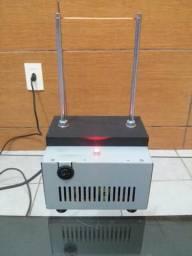 Máquina para cortar e selar fitas e outros materiais sintéticos