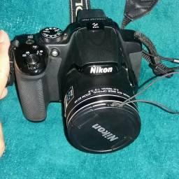 Câmera Nikon, máquina de fazer dinheiro!