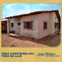 Terreno com casa inacabada no JD Tropical