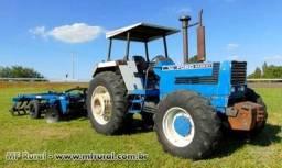 Trator Ford/New Holland 8430 140 cv equipado com Grade Aradora Baldan 20x26 4x4 ano 94