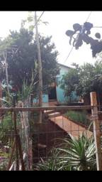 Vendo terreno com duas casas  de madeira