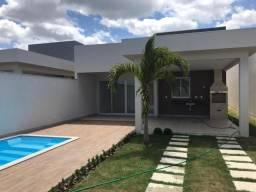 Casa com 03 quartos sendo 02 suítes e área de lazer com piscina e churrasqueira
