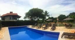 Chácara de alto padrão com 3 suítes, piscina, pomar, quadra esportiva, espaço gourmet e mu