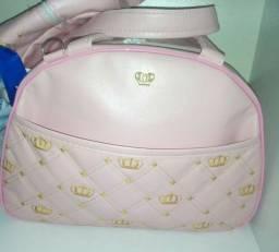 Vendo bolsa grande e um isopor rosa usada uma vez