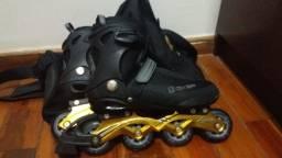 patins oxer abec 7 aluminium preto com dourado + bolsa para patins oxelo