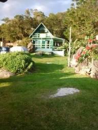 Terreno com 15 mil m²,próximo a praia, linda vista,com duas casas no terreno,Ribeirão