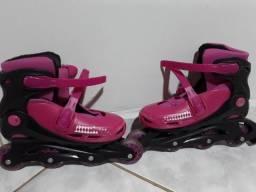 Par de patins e acessorios de segurança 130.00