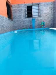 Casa com piscina 2 minutos da praia