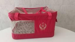Bolsa para transporte de cães e gatos.