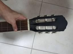 Violão preto, acompanha cordas novas, capotraste e 2 palhetas