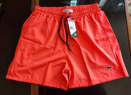 Título do anúncio: Short M laranja Neon