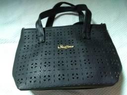 Bolsa de mão versátil