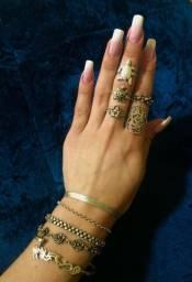 Anéis e pulseiras de prata maciça
