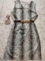 Vestido em sarja macia com muito elastano.<br>Veste 48/50 ótimo.
