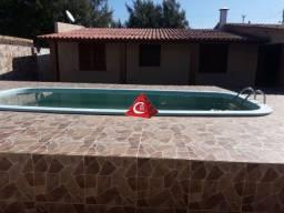 Casa espaçosa com anexo e piscina em Cidreira para Venda