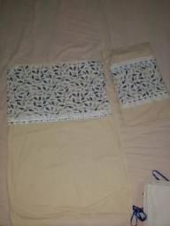 Sasapego de lençóis de berço com fronhas