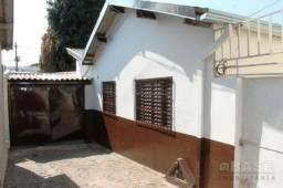Casa com 3 dormitórios para alugar por R$ 690,00/mês - Centro - Araguari/MG