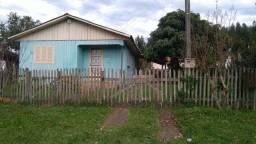 Vendo casa com patio fechado