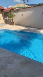 Casa com piscina a 100 metros do mar