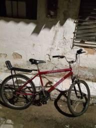 Vendo essa bicicleta em perfeito estado. E negócio o preço
