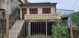 Casa 02 Dormitorios c/ garagem - Bairro Nonoai