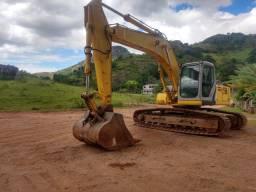 Vendo ou troco Escavadeira New Holland 215B 2014