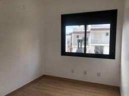 Título do anúncio: Casa com 2 dormitórios à venda, 112 m² por R$ 470.000,00 - Guarujá - Porto Alegre/RS