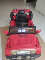 Título do anúncio: Carrinho elétrico Infantil conversível,na cor vermelha.