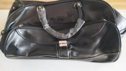 Título do anúncio: Vendo bolsa mala em couro com rodinhas Haimashi