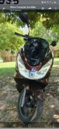 Título do anúncio: Vende-se uma moto pcx  150