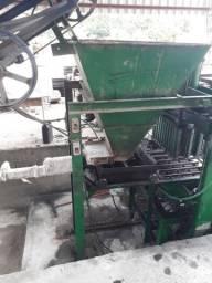 Maquina de fabricar blocos pneumatica