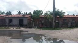 Venda ou troca um terreno com 3 casas.mt:27 de frente com80 fund.em h. de campos
