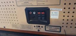 Toca-discos retrô, com CD player e tocafitas, para conversão digital.