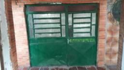 Vendo porta usado de garagem,bom estado e de barbada